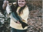 Hello this is the first big bass my little girl ever caught she was age ten at the time ,it was fall i had been trying to teach her texas rigging ,she learned good lol .She was fishing a junebug colored original culprit worm ,it was fall in a lotus infested pond my aunt owns ,thank you sincerely David Collins my daughters name is Shelby Grace Collins