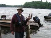 June 2012 on Little Spider Lake in Wisconsin.  43 Inches and 22 Lbs.  Only out of the water for picture.  Released.  Caught on a Lindy Musky Killer, fish scale blade and black bucktail.