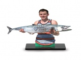 I caught this King Mackerel on the Yucatan Peninsula in Mexico last December. It weighed 28 lbs. The photo was bonded onto a piece of acrylic, and me and the fish were cutout and mounted on a stand. It's called a Fototrophy, and I keep it on the desk in my dorm room.