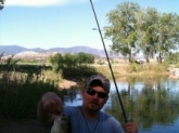 Caught this 18 inch largemouth bass in a small Colorado pond using a strike king bitsy tube jig.