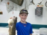 Caught by Carsen  in Janesville, Wi. on the Rock River. 19 1/2 inch Walleye.  Carsen is one of your biggest Fans!