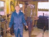 This is my dad Tommy Q Frederick,  he caught the fish (flat-head catfish) at Santee Cooper in South Carolina.  It was estimated at 150 lbs because they didn't have a big enough scale to weight it. Took them 2 hrs to bring it in to shore.   He caught it in 4 feet of water in December of 06.     He was and still is a very happy fisherman.  Thank you,  (his daughter)   Doris Lynn Frederick Minteer