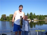 Mike Foreman with my nephew Seth Scott Foreman on lake James in Prudenville, MI  I taught my nephew to fish when he was 2 years of age, this nice Largemouth he caught in September of 09 he was 9 years of age