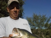 My husband (Ramiro Garza Jr.) caught this 10lb 22 inch largemouth bass in a private pond near Brehnam Texas on  October 4, 2014