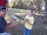 This is the bass my son caught at his 5th birthday party, and his uncle helping him to display it. My baby even kissed his fish before he released it!