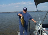 This smallmouth was caught on a crankbait on Chippewa Lake in mid Michigan that is more known for its pan fish.  It was caught and measured but not weighed, but it qualified for a Michigan Angler award due to its length which was 28 inchs and then released under my dock.  A previous angler award is on my hat in the picture.... that was for a bowfin (dogfish) also caught in Chippewa Lake.