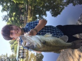 Took my nephew Lucas fishing on the Chickahominy River and he caught this nice Bass.  His first catch ever!
