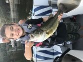 Reece my 6 year old son caught this bass on Lake of the Ozarks in October of 2017.  He caught and landed this fish all by himself. He was using a bass pro xps square bill in five feet of water off a sea wall in late afternoon.  The bass weighed almost five and a half pounds.