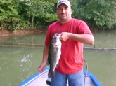 I CAUGHT THIS FISH AT STONEWALL JACKSON LAKE IN WEST VIRGINIA. I CAUGHT IT ON A BANDIT CRANKBAIT AND WIEGHED ABOUT 6LBS. I CRANKED IT OVER THE LOG BEHIND ME AND ABOUT JERKED THE ROD OUT OF MY HAND. THE BIGGEST BASS I'VE EVER CAUGHT.