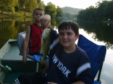 I THOUGHT THIS PICTURE WAS FUNNY! MY YOUNGEST SON WAS A LITTLE JEALOUS OF THE FISH MY OLDEST SON CAUGHT. HE CAUGHT IT IN A PRIVATE LAKE IN W.V. WASN'T VERY BIG BUT WE HAD FUN.