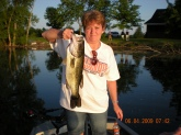 This is a photo of my wife with a 6 lbs 8 oz large mouth bass caught in a Interstate pond in North west  Illinois.She loves to fish them, we caught lots of fish, this is the biggest she has ever caught.We were throughing a white mouse on top.