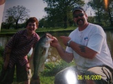 Cameron Jones caught this bass in a private pond. Dad is holding the