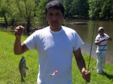 Luepe caught his very first fish ever! I had no idea when I handed him a rod and real that he did not know how to use it. I just thought everyone knew how.  He was very excited and ask me to go fishing alot now. He caught this fish on Lake Clara in Hickory Withe, TN. This is a private lake and we were given permission from a homeowner named Jack Buzard. Thanks Jack.