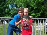My boys, Jonathan (left) and Matthew (his fish) with the 31 oz. shellcracker caught from our pond on the farm in Louisburg, NC. I'm one proud poppa.