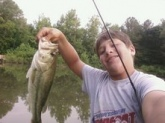 i cought this bass in dalton ga at a pond beyind my house it weighd bout 5 pounds and cought it with a blue and yellow sparkling rattle trap.