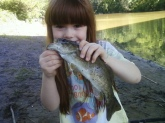 My daughters first fish caught in beaver creek in ohioville pa caught it with a nightcrawler on the bottom on my pole while i wasnt paying attention because i was tieing a hook on her line