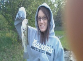 my first bass :) he was small but he got me hooked on bass fishing!