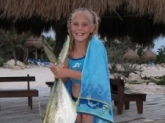 My daughter with a Jack I caught off of the beach last year in Cancun