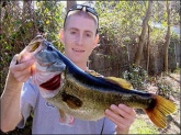 Hello everyone. Here's a photo of my largest bass. It weighed over 8lbs. I hooked and landed the fish on 1/15/05 in the panhandle of Florida, at where I call the Special Lake, using 8lb line and a Quantum Energy 20 spinning reel from the bank. Fish on.  Rick