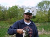 This is my son Johnny. We were fishing with shiners in a farm pond in Md. near Baltimore when this 3lb. 1 oz. largemouth hit.